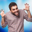 Young man doing aggressive gesture — Stock Photo #62768109