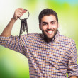 Young man holding old keys — Stock Photo #62768435