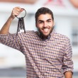Young man holding old keys — Stock Photo #62768461