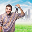 Young man holding old keys — Stock Photo #62768471