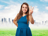 Pretty young woman counting with fingers — Stock Photo