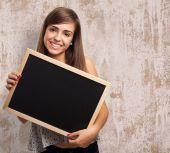漂亮的学生举行黑板 — 图库照片