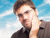 Young man suffering strong toothache — Stock Photo