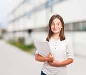 Cute girl holding notebook — Stock Photo
