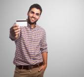 Young man showing credit card — Stock Photo