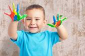 Cute kid with hands paint — Stockfoto