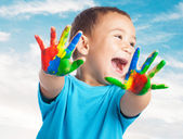 Cute kid with hands paint — Stock Photo