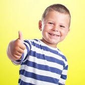 Cute kid doing positive sign — Stock Photo