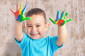 Cute kid playing with paint — Stock Photo