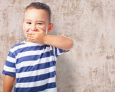 Cute kid covering his mouth — Stock Photo