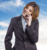 Executive young woman talking on telephone — Stock Photo