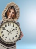 Young woman with big clock — Stock Photo