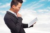 Asian man using tablet — Stock Photo