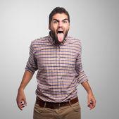 Young man showing his tongue — Stock Photo