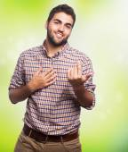 Handsome man doing love gesture — Stockfoto