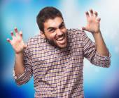 Young man doing aggressive gesture — Stock Photo