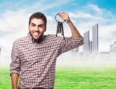 Young man holding old keys — Stock Photo