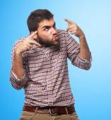 Young man doing crazy gesture — Stock Photo