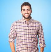 Handsome young man smiling — Stock Photo