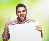 Young man holding placard — Stock Photo