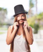 Pretty girl imitating a man — Stock Photo