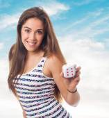 Pretty girl holding a dice — Stock Photo