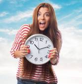 Woman holding a big clock — Stock Photo