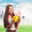 Girl inserting coin in a piggybank — Stock Photo #66612681