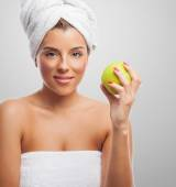 Woman after a bath with apple — Stock Photo
