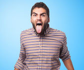 Man showing his tongue — Stock Photo