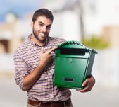 Man holding a mailbox — Stock Photo