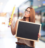 Woman holding a board and a pencil — Stock fotografie