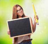 Student holding a chalkboard and a pencil — Stock Photo