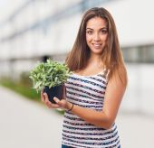 Girl holding a plant — Stock Photo