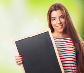 Student holding a little chalkboard — Stock Photo