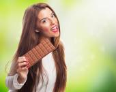Young woman holding a chocolate — Foto Stock