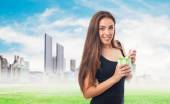 Girl holding a paint can — Stock Photo