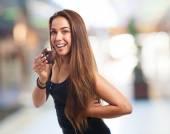 Woman biting a chocolate donut — Stock fotografie