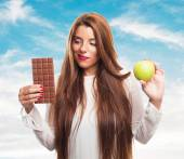 Woman having a dilemma with her diet — Stock Photo