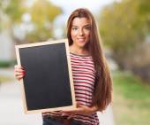 Student holding a little chalkboard — Zdjęcie stockowe