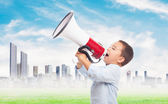 Boy shouting with the megaphone — Stockfoto