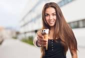 Woman holding an ice cream — Стоковое фото