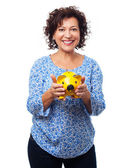 Woman putting a coin on a moneybox — Stock Photo