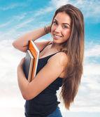 Junger student holding bücher — Stockfoto