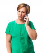 Woman talking by telephone — Stock Photo