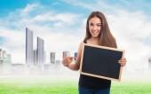 Woman holding a chalkboard — Stock Photo