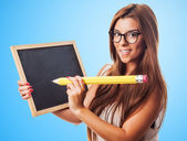 Student with big pencil and chalckboard — Stock Photo