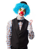 Clown holding a lollipop — Stock Photo