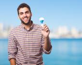 Man holding a sand timer — Stock Photo