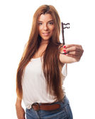 Woman holding a house key — Stock Photo